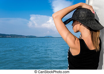 Woman in hat at summer