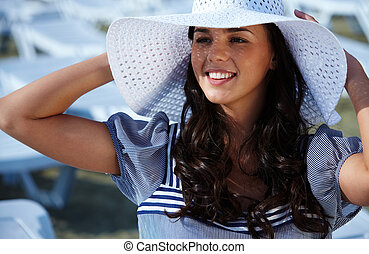 Woman in hat - Young pretty woman in white hat enjoying warm...