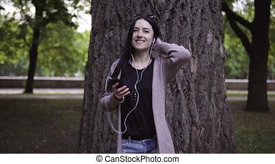 woman in headphones is dancing