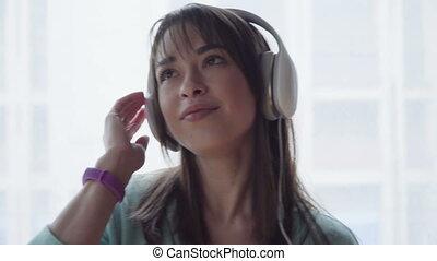 woman in headphones is listening to music