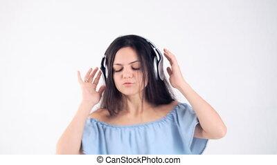 woman in headphones listening music