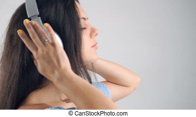 woman in headphones listening music