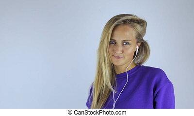 Woman in headphones listening to music
