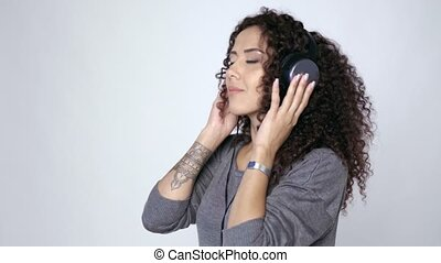 Woman in headphones listening to music dancing