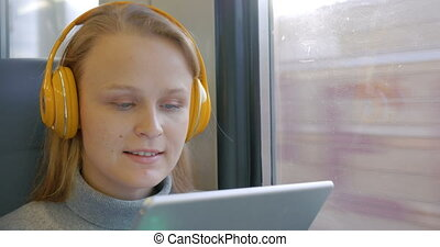 Woman in Headphones Listening to Music on the Way