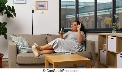 woman in headphones listens to music on smartphone - ...
