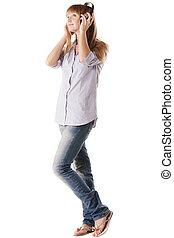 Woman in headphones looking to side