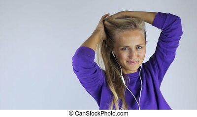 Woman in headphones on white background