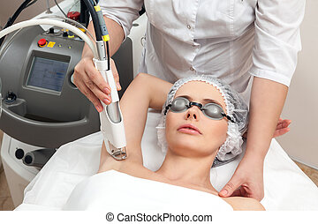Woman in healthy beauty spa salon - Woman lying on a table...