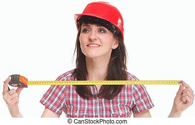 Woman in helmet holding a tape measure