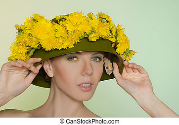 Woman in  helmet with a wreath of dandelions