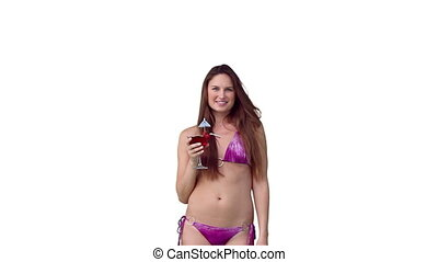 Woman in her purple bikini with a drink in her hand