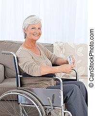 Woman in her wheelchair - Woman looking at the camera in her...