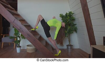 Woman in high heels doing lunge exercise on stairs - Elegant...