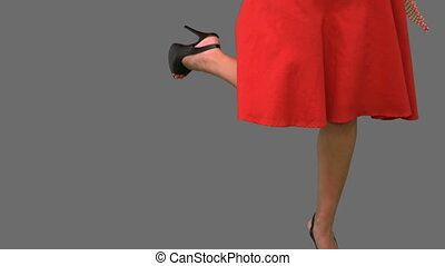 Woman in high heels holding a broken umbrella