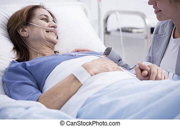 Woman in hospital with volunteer