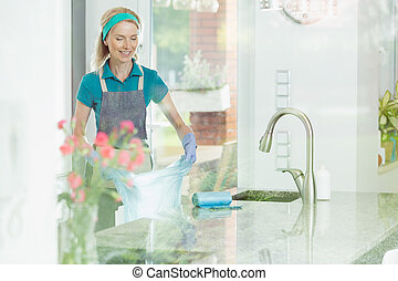Woman in house cleaning service