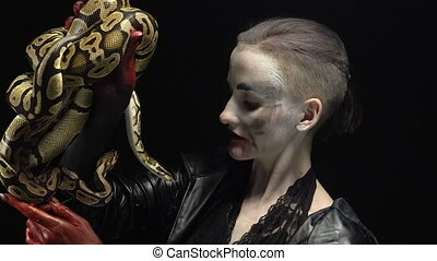 Woman in image holding two pythons - Footage of horror woman...