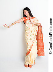 Woman in Indian sari dress dancing