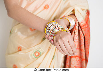 Woman in Indian sari dress wearing bangles