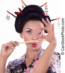 woman in Japanese kimono with sushi