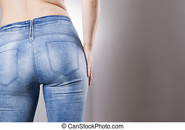 Woman in jeans close up. Beautiful female hips and buttocks