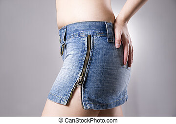 Woman in jeans skirt close up. Beautiful female hips and...