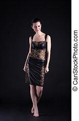 woman in lacy dress walk on tiptoe