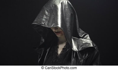 Woman in leather black hood - Footage of woman during ritual...