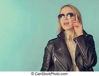 Woman in leather jacket in retro style