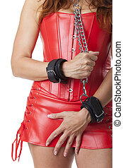 woman in leather with cuffs and chain