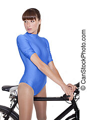 woman in leotard on bike