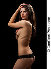 Woman in lingerie isolated on black
