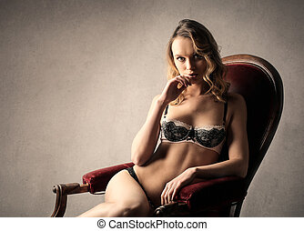 Woman in lingerie on chair