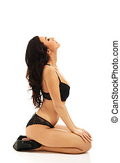 Woman in lingerie sitting on knees