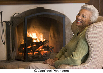 Woman in living room laughing