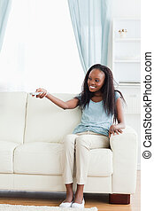 Woman in living room with remote