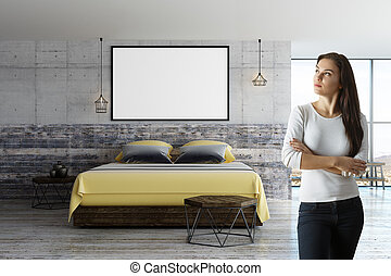 woman in loft room with blank poster