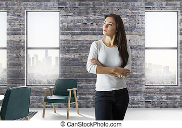 woman in loft room with city view