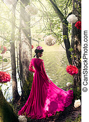 Woman in long pink dress in the wood - Young beautiful woman...