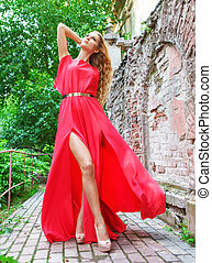 Woman in long red dress outdoors