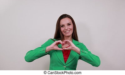 Woman In Love Shows Heart Shape With Her Hands. Flirting Seducing A Person