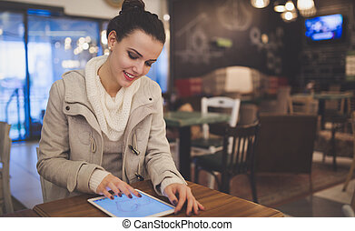 Woman in love using tablet