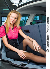 Woman in luggage compartment