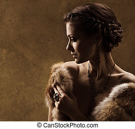 Woman in luxury fur coat, retro vintage style