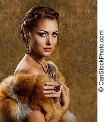 Woman in luxury golden fox fur coat, retro style