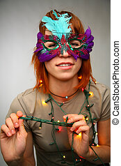 woman in mask with garland