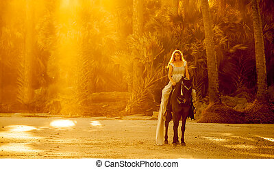 woman in medieval dress on horseback on forest beach