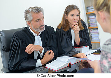 Woman in meeting with two legal professionals