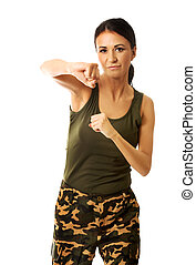 Woman in military clothes boxing to the camera